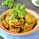 Arbi ki sabji served in a patterned bowl and garnished with fresh cilantro