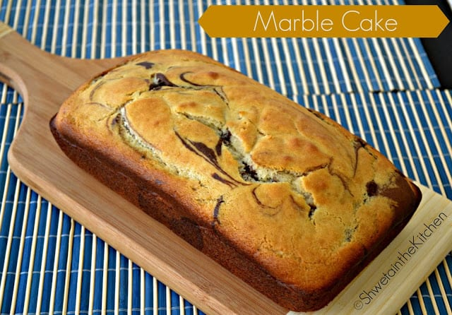 A chocolate marble cake on a wooden chopping board