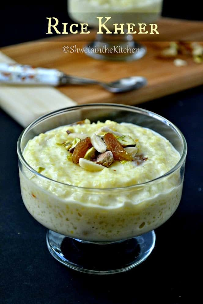 rice kheer served in a glass bowl and topped with nuts