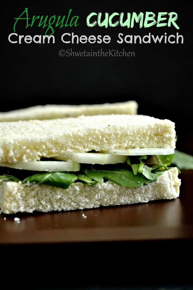 A cucumber sandwich on a black background with text overlay