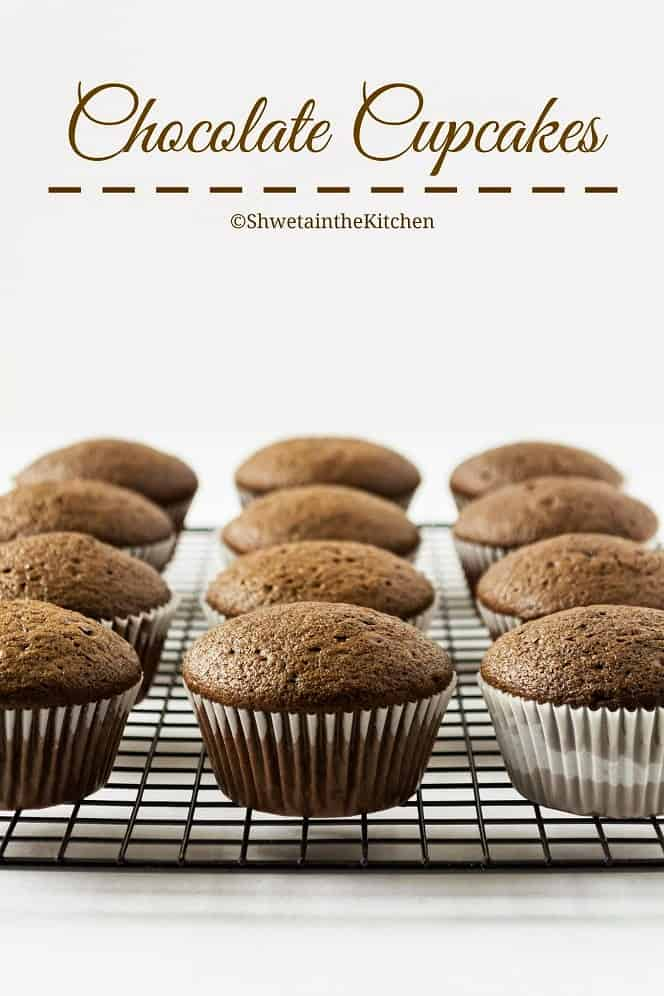 Chocolate cupcakes on a cooling rack before being frosted