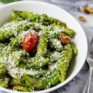 Spinach and basil pesto basil in a white bowl