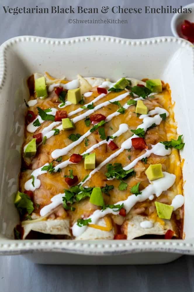 Baked black bean enchiladas in a white dish with text overlay