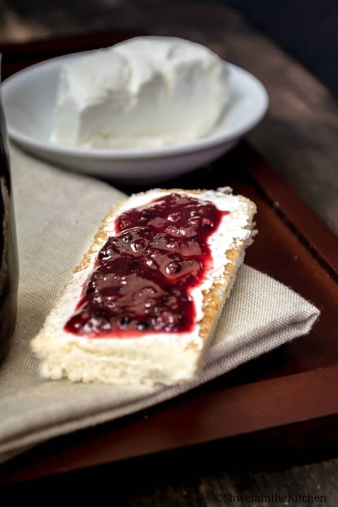 Cream cheese spread on toast and topped with a layer of spicy plum chutney