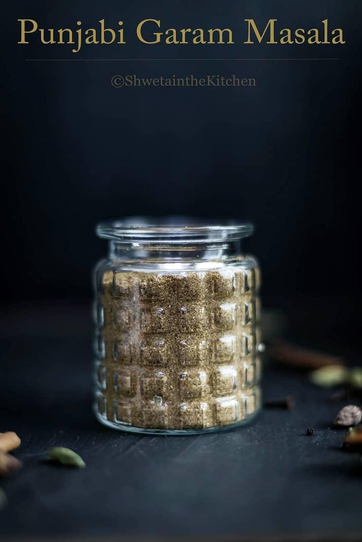 Homemade garam masala in a glass jar with text overlay