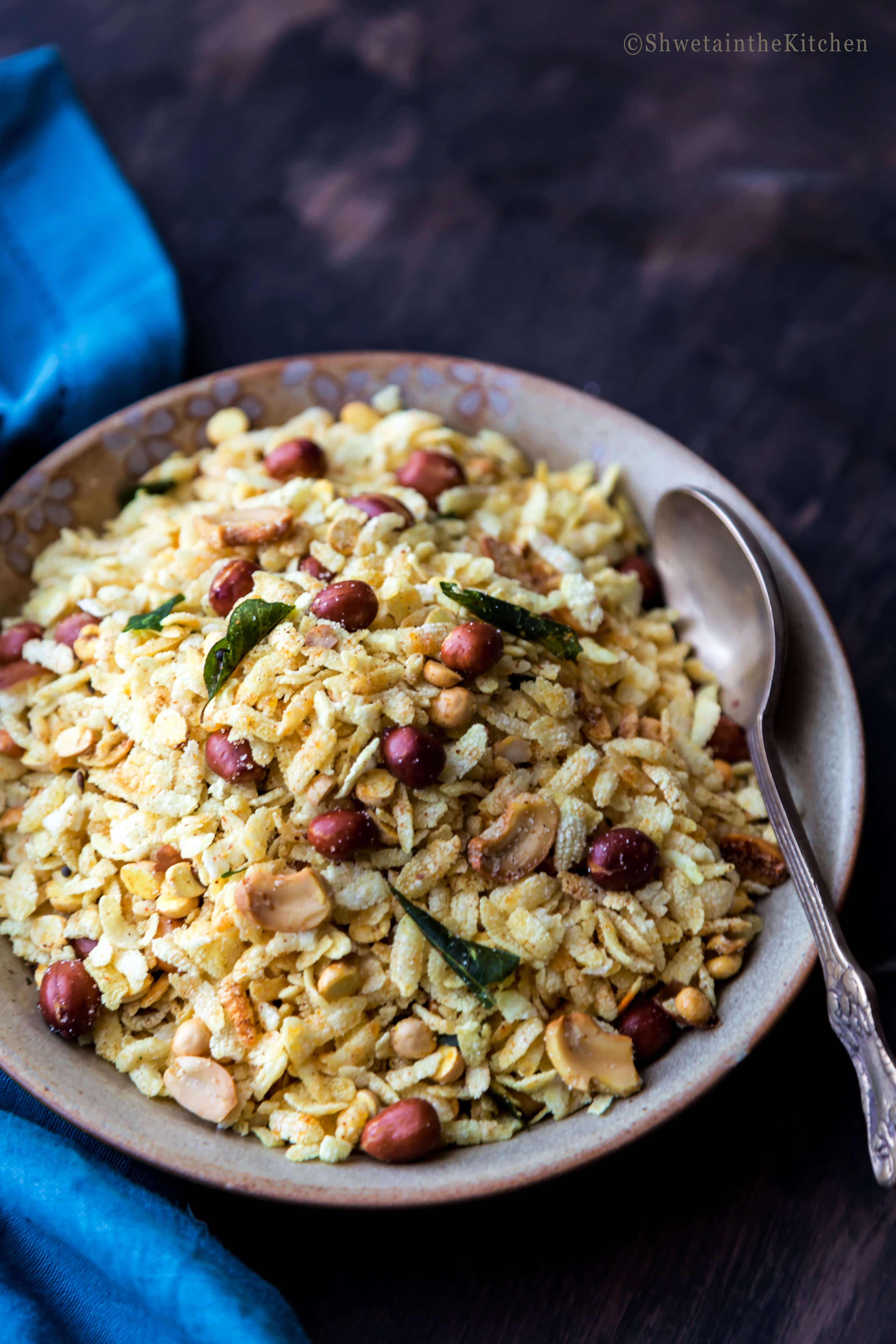 side shot of Poha Chivda in a plate with spoon