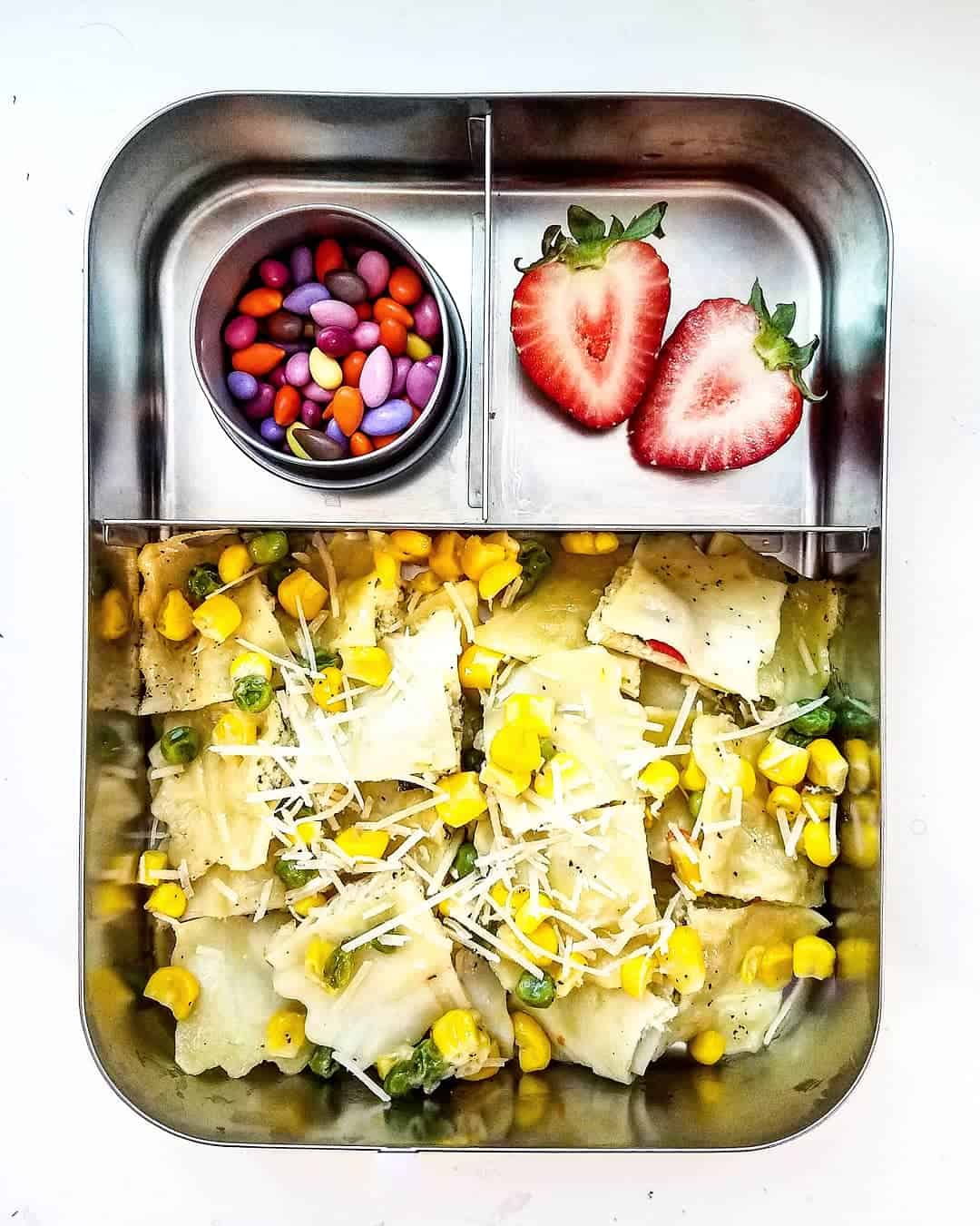 Ravioli sauteed with corn, peas and lots of parmesan cheese, Dry free chocolate covered sunflower seeds and Strawberry