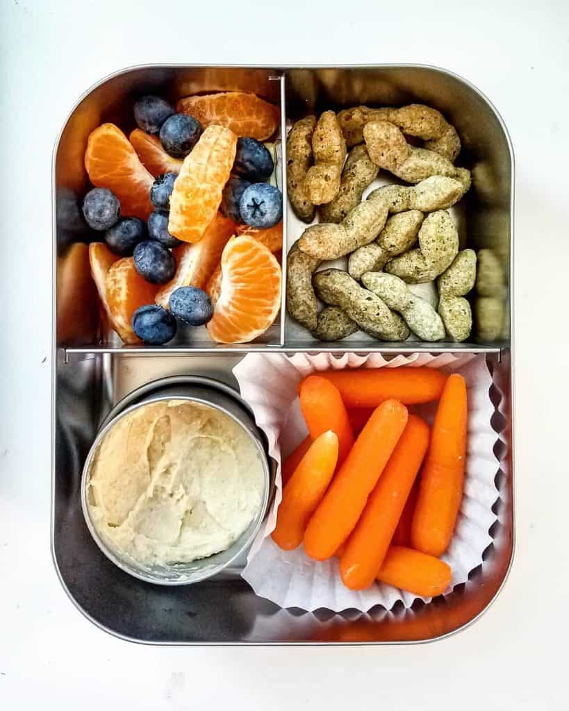 Baby Carrots with Hummus, orange slices with blueberries and Edamame puffs