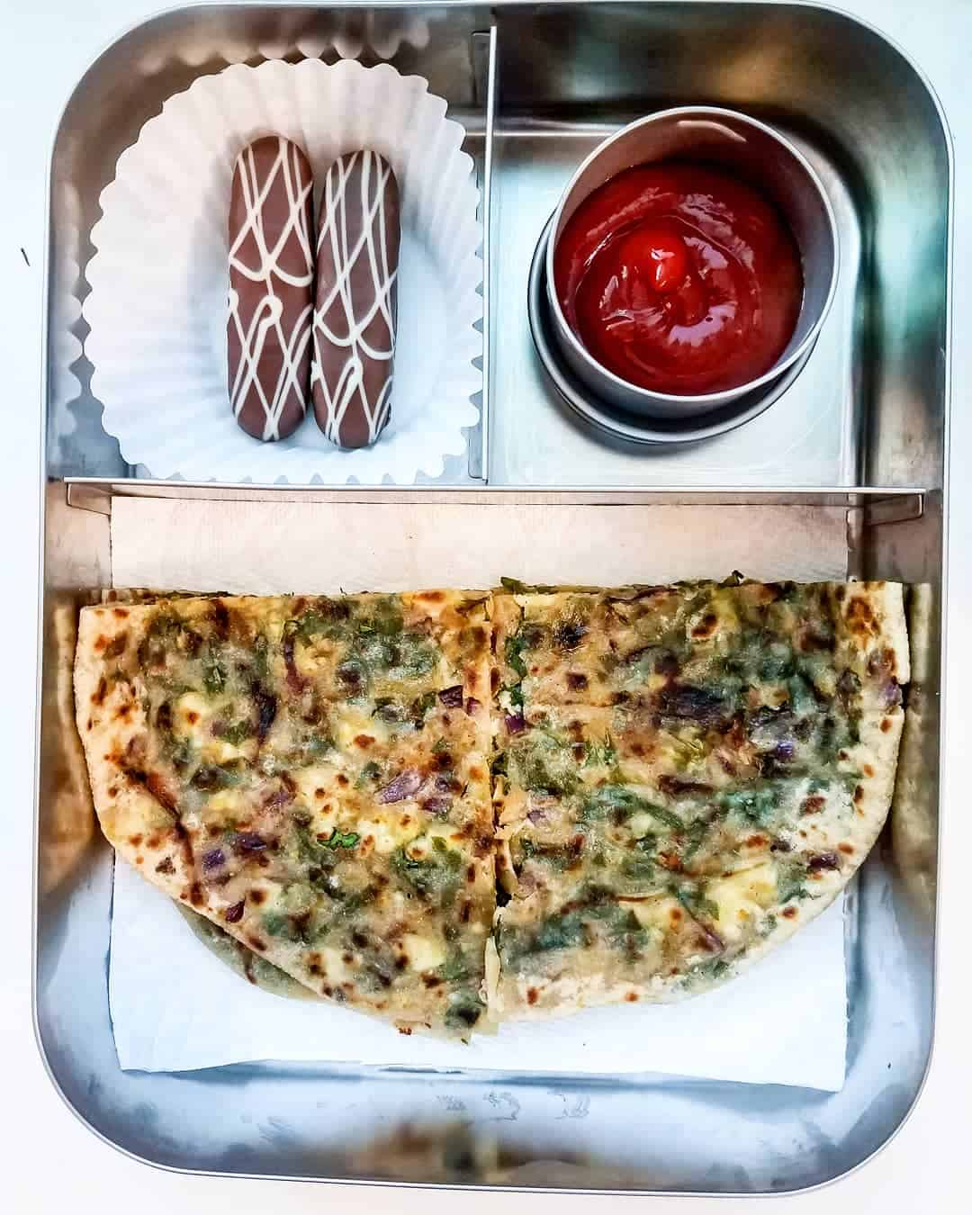 Palak Paneer Paratha ( spinach and cheese stuffed whole wheatflatbread), ketchup for dip-dip and Belgium cookie as sweet treat