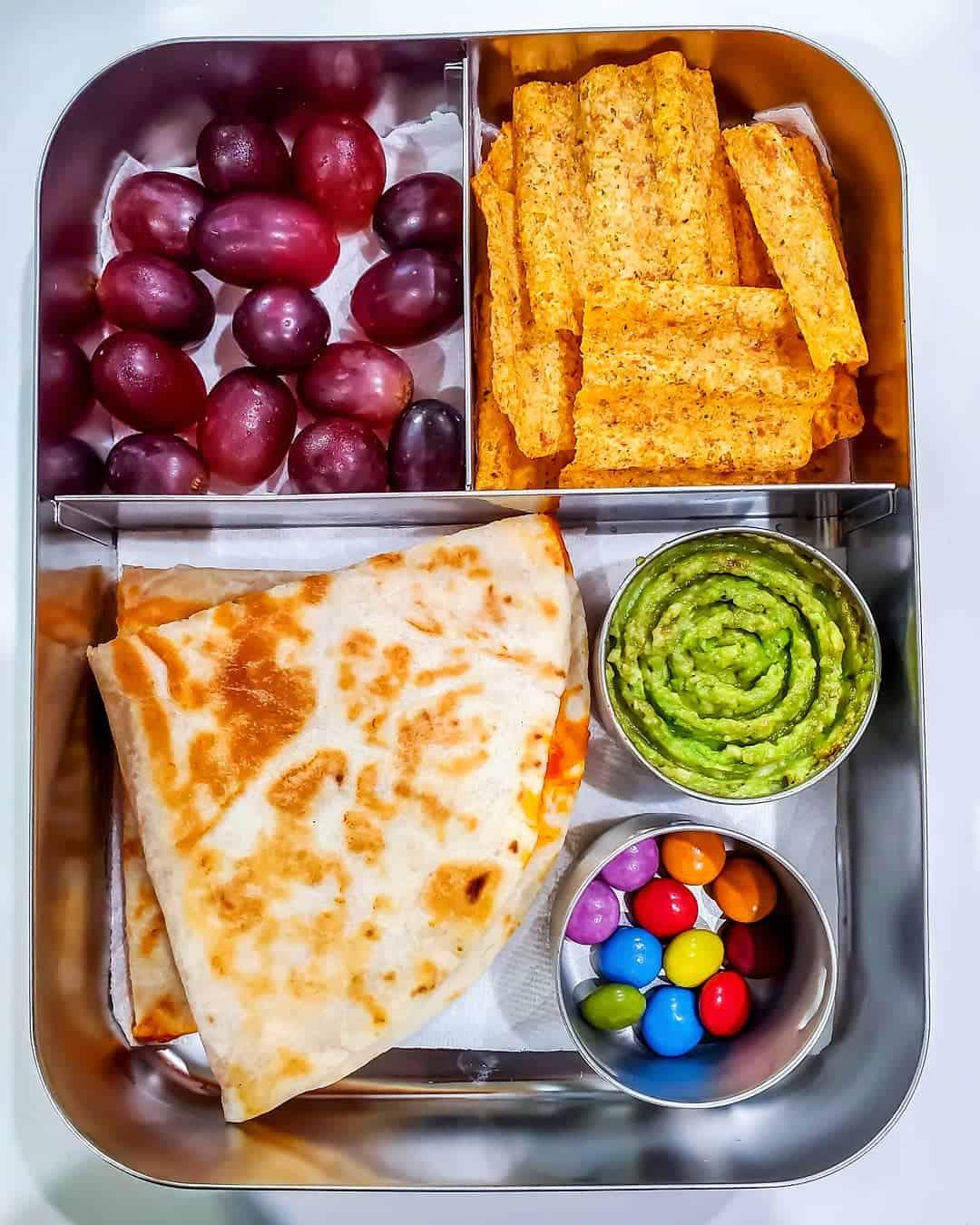 Quesadilla,Guacamole, chips, grapes and chocolate drops