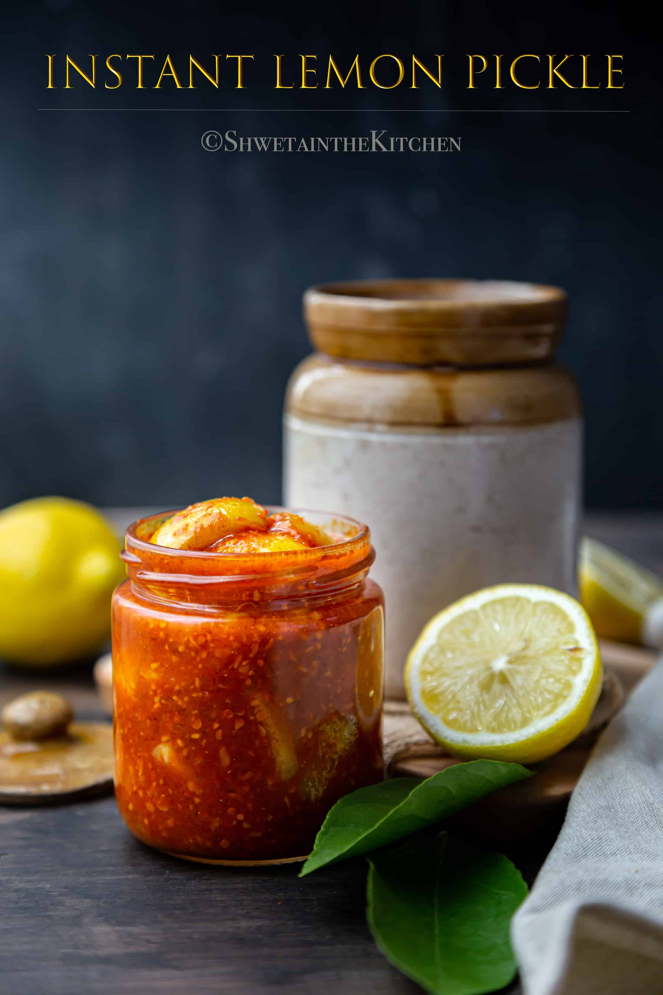 Another jar full of Instant Lemon Pickle with Ceramic jar and cut lemon on side