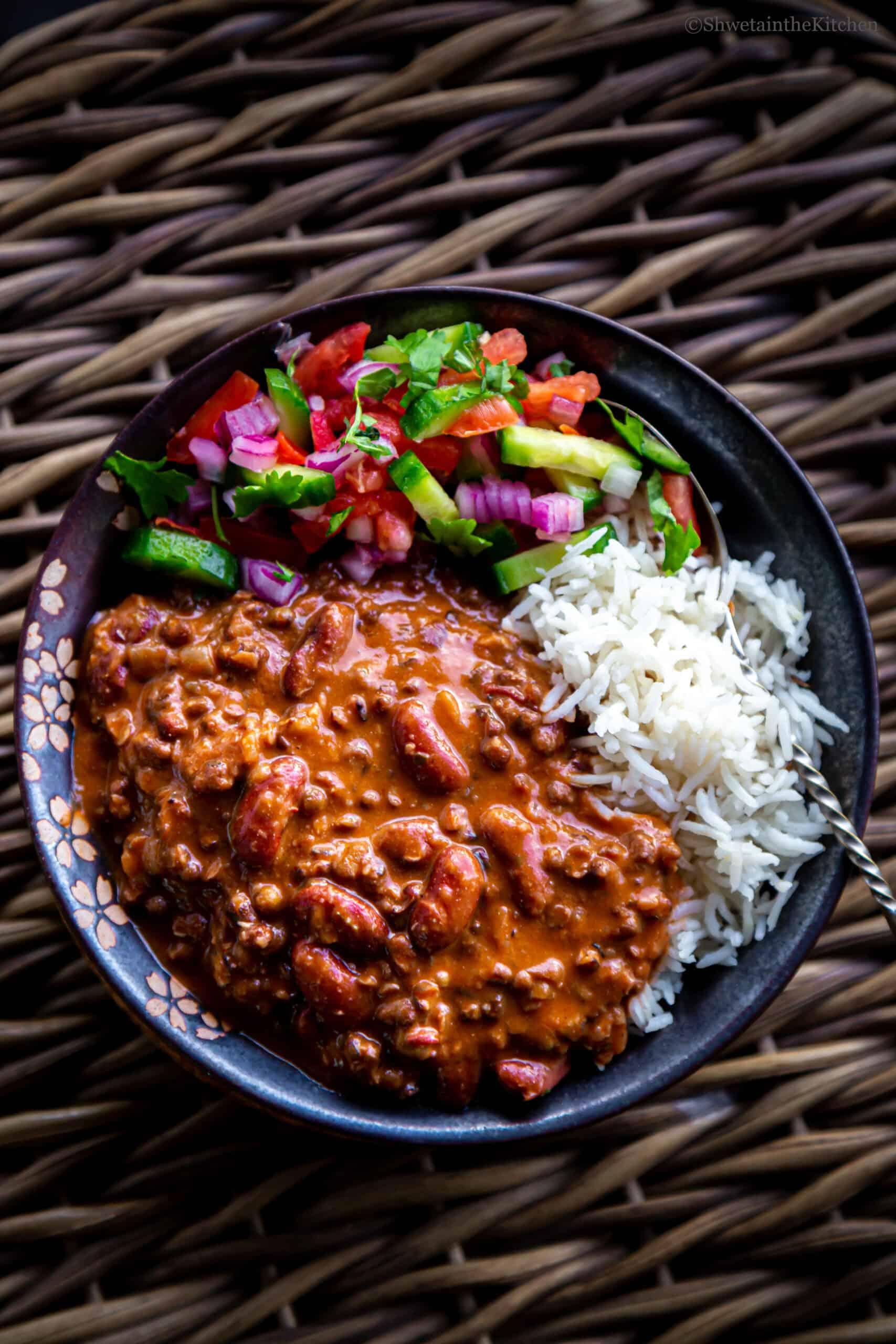 bowl of Dal Makhani, rice and salad together