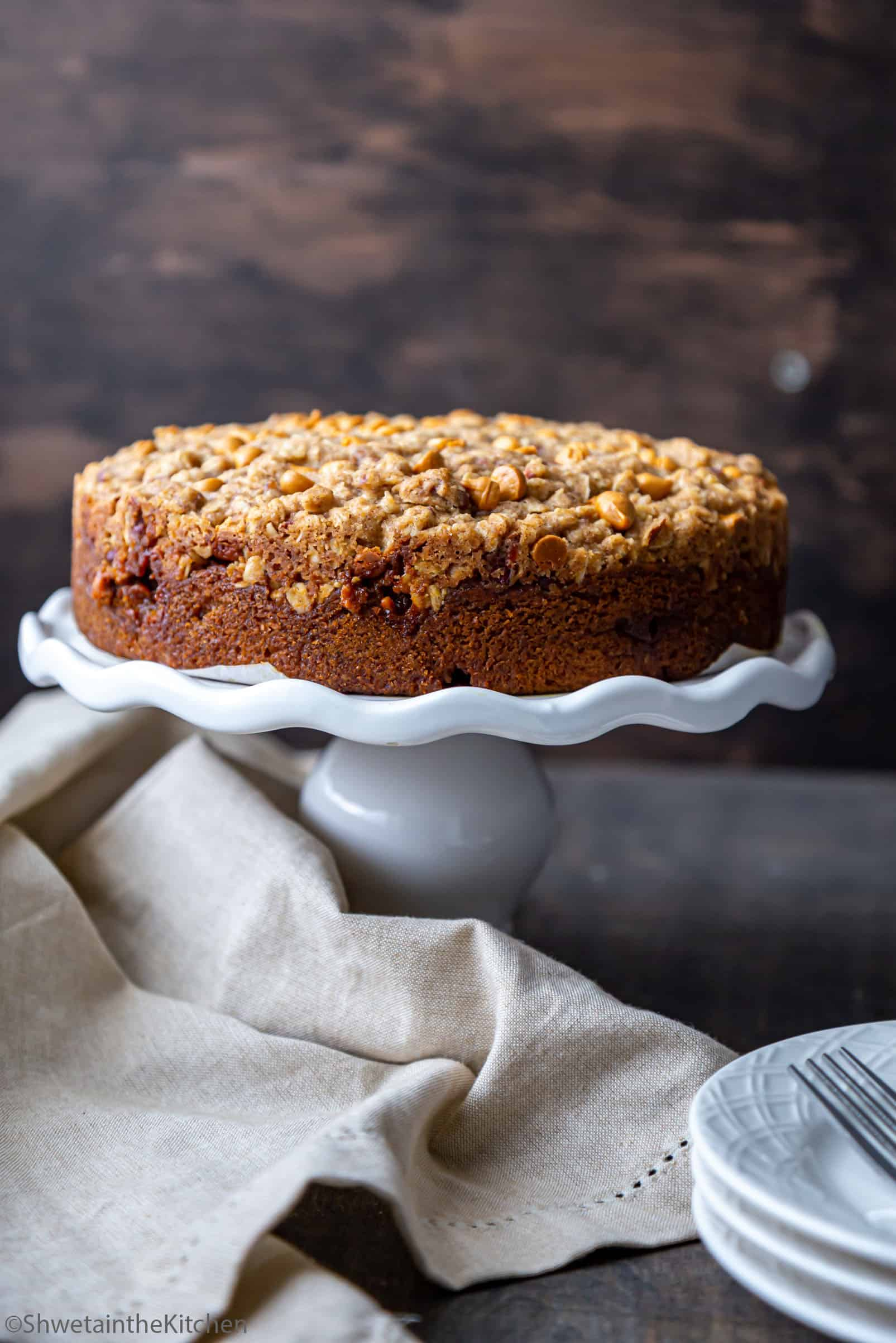 Side view of Pumpkin Streusel Coffee Cake on a cake stand