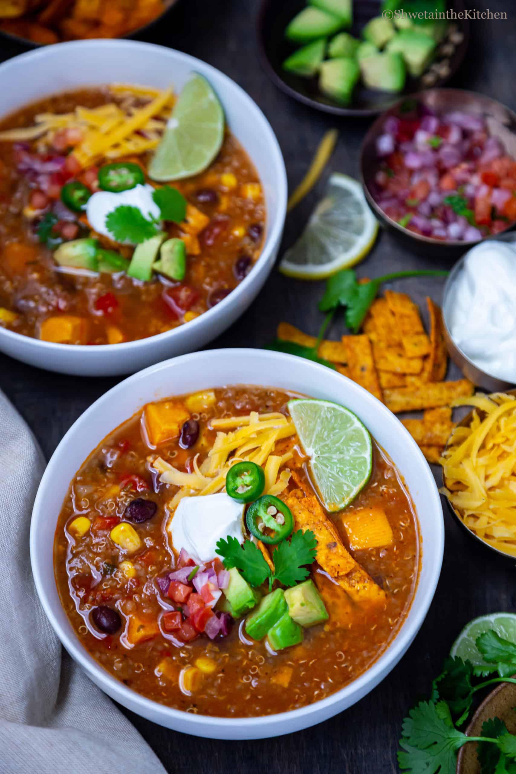 Side view of Quinoa Enchiladas Soup in white bowl