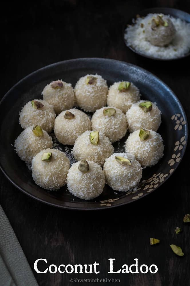 ¾th side/slant angle view of a plate full of coconut ladoo