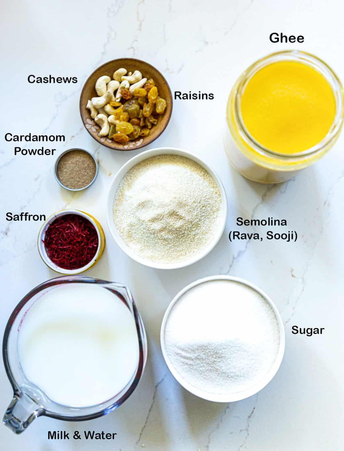 Ingredients for rava sheera laid out on marble surface