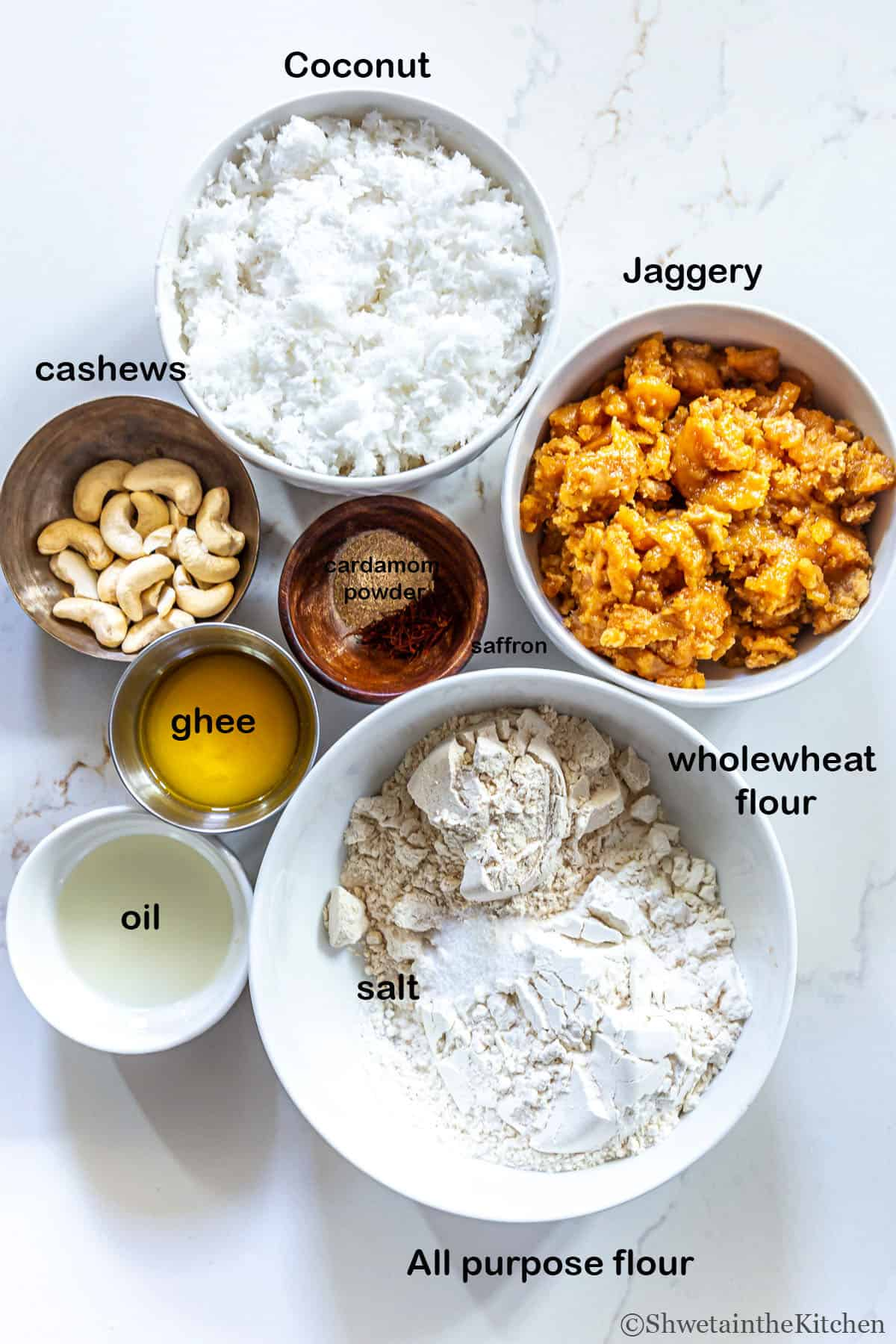 Fried Modak Ingredients laid out in bowls on a white marble surface.
