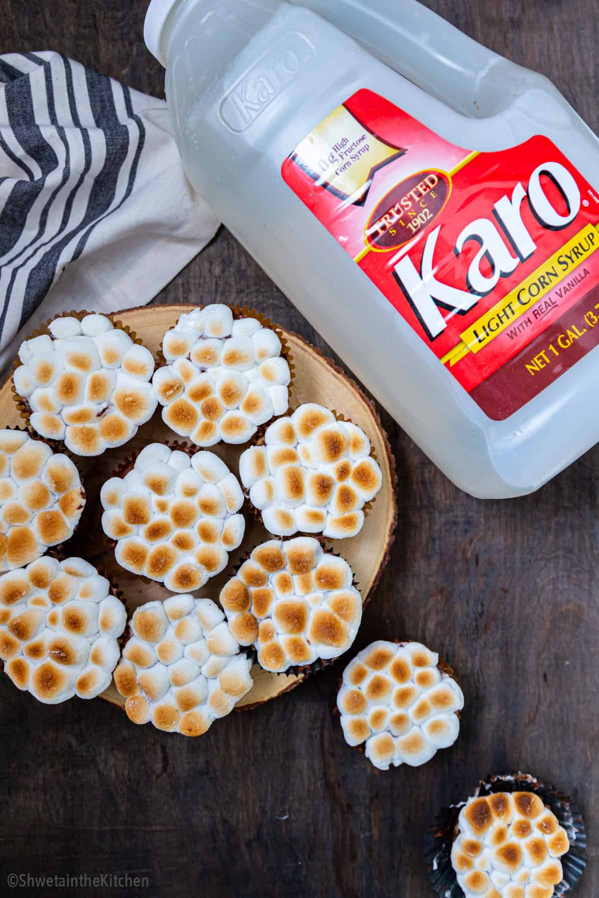 10 Brownie Scotcheroos Marshmallow cups on a round serving board with karo corn syrup