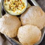 3 poori with bowl on shrikhand on silver plate