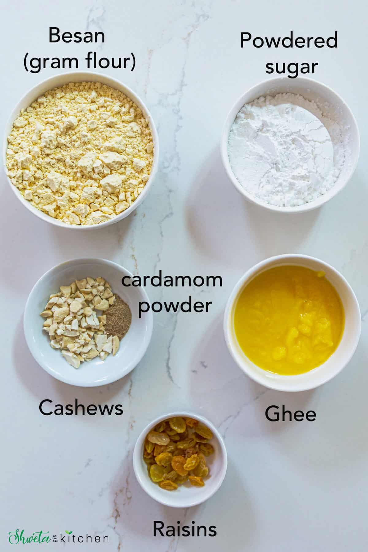 ingredients for besan ladoo recipe in white bowls on a marble surface