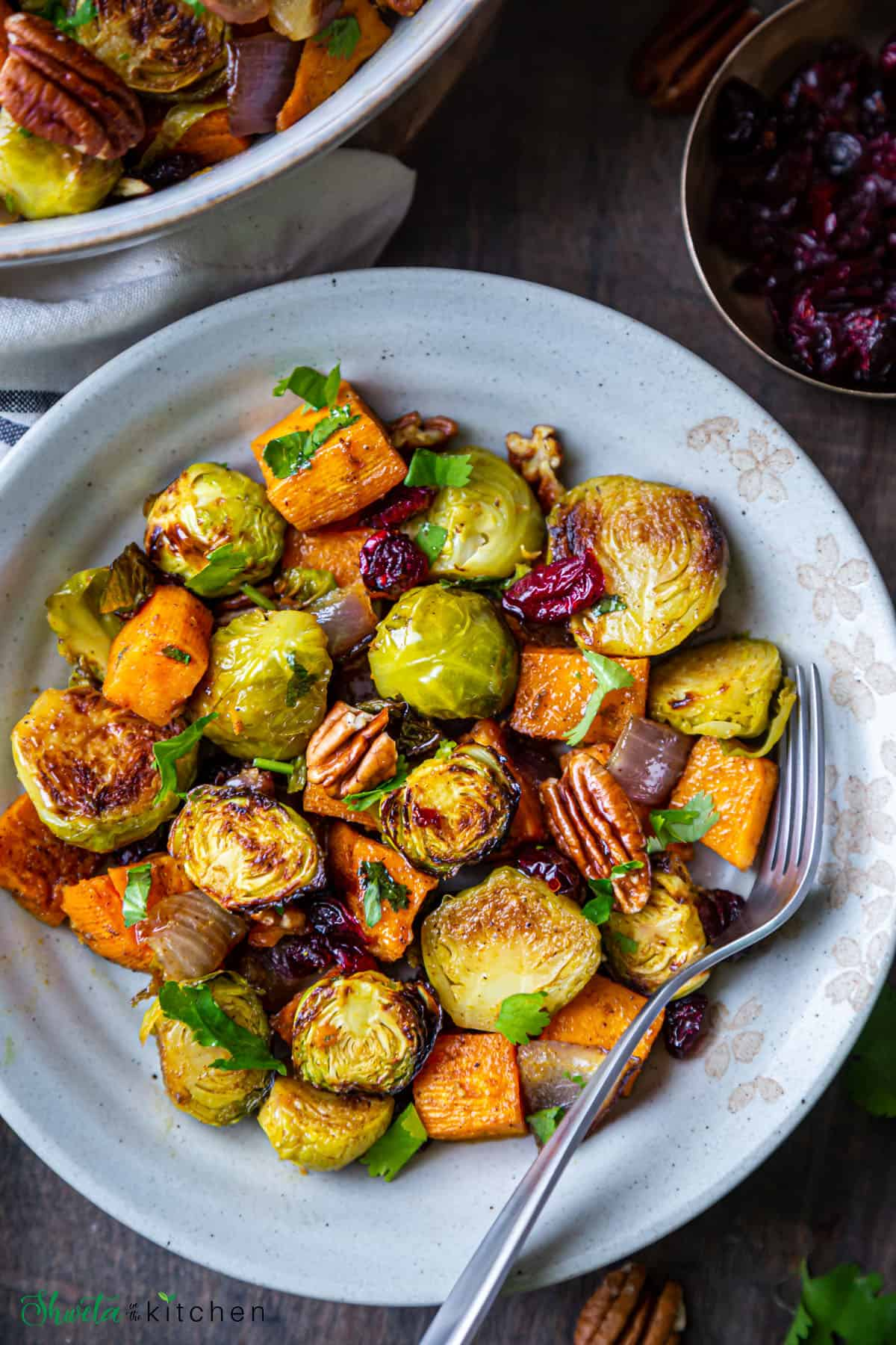 sweet potatoes andbrusselssproutsin on white plate