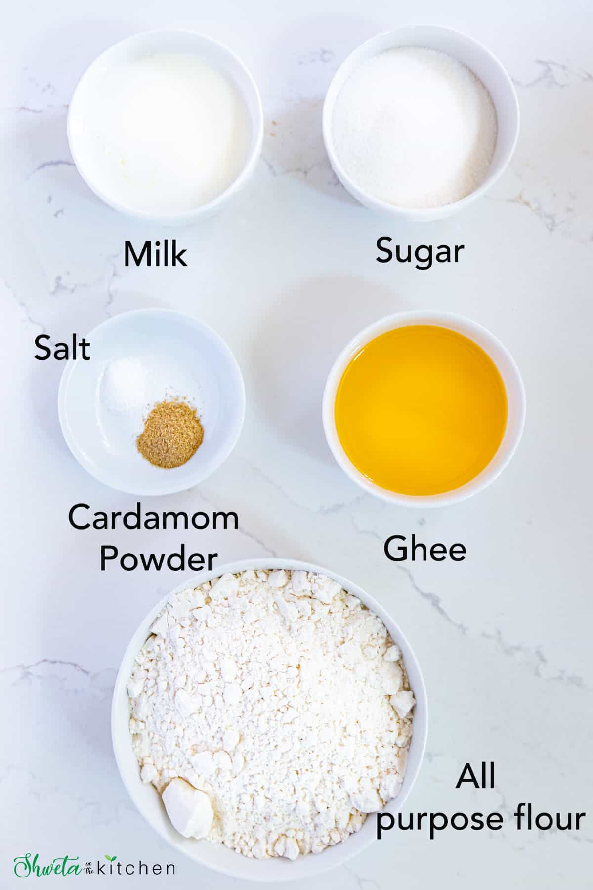 Sweet Shankarpali ingredients in white bowls on a marble surface