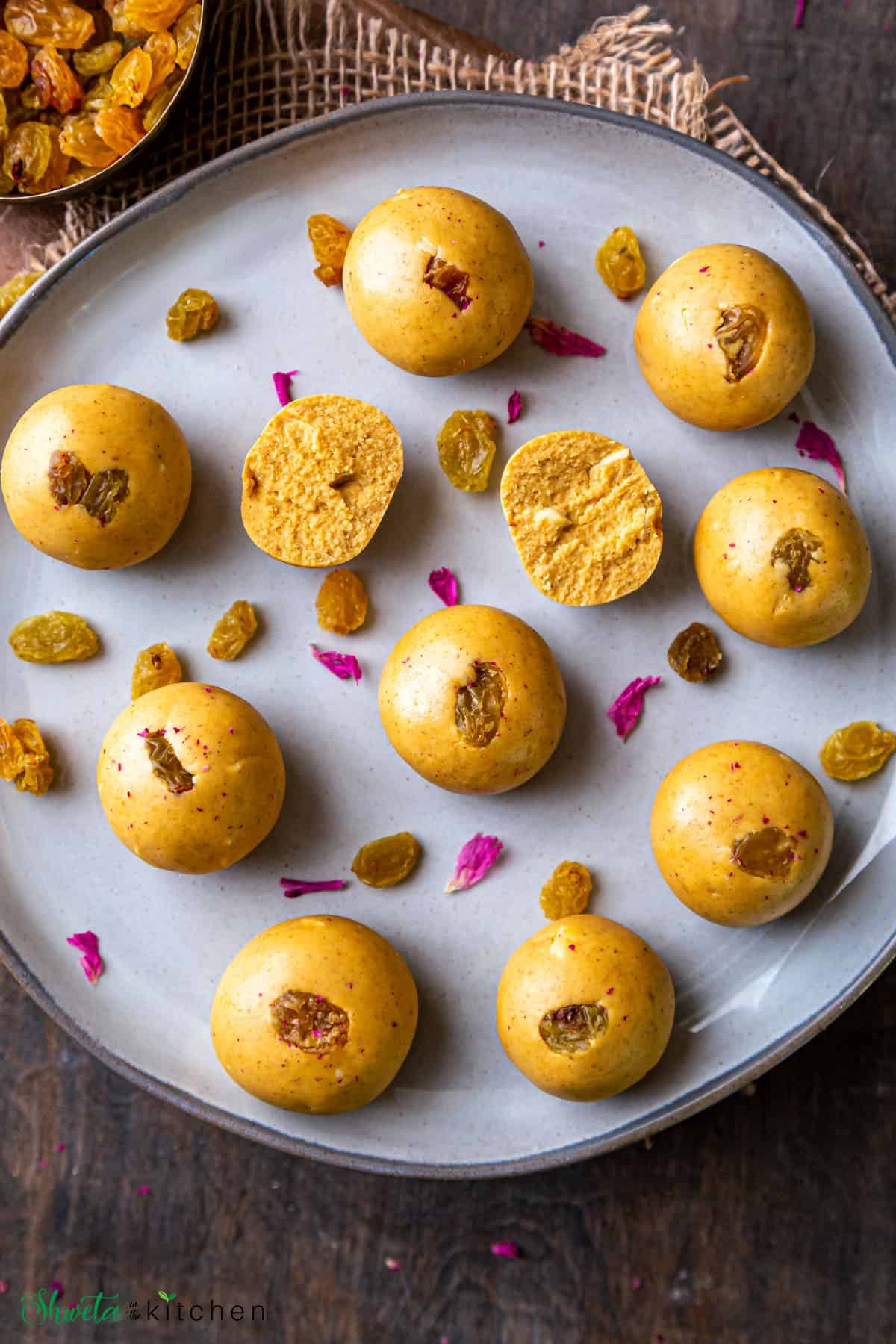 Besan ladoo on plate with one split open