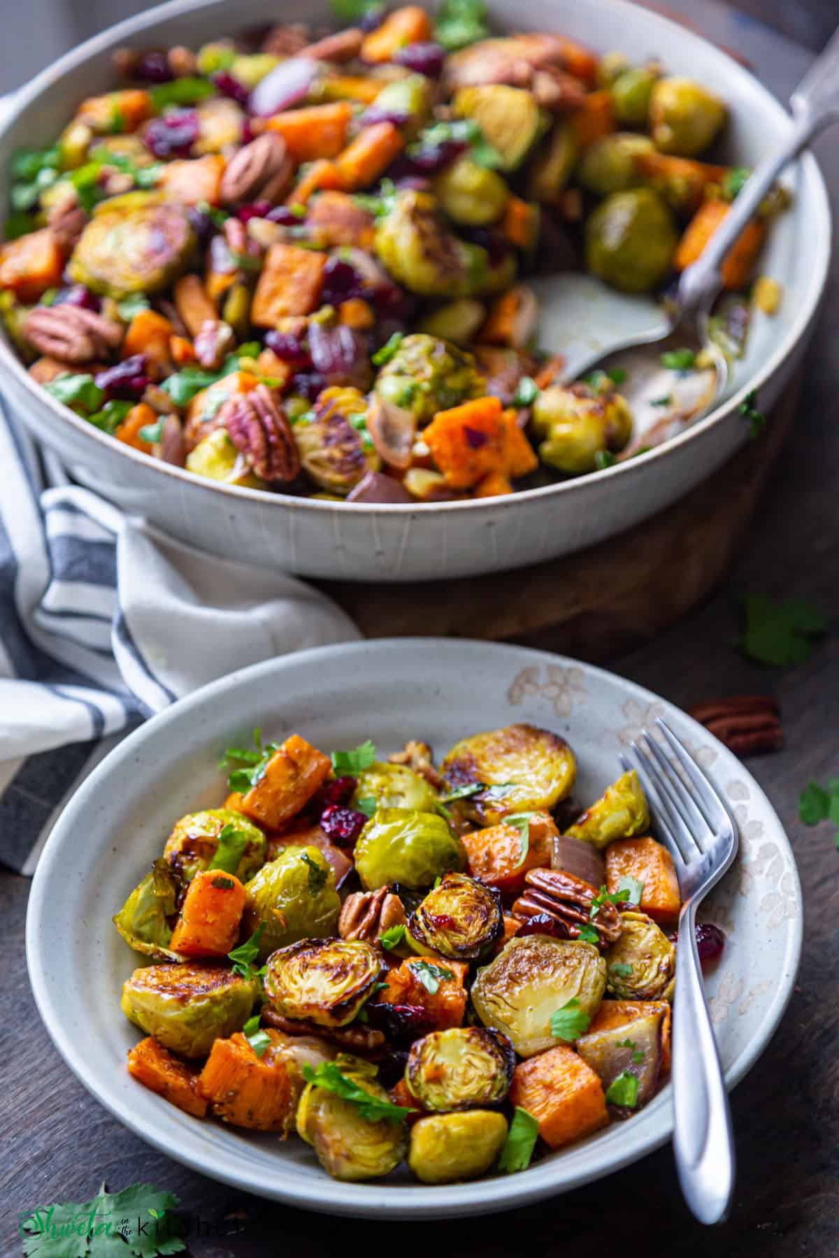 two bowls of sweet potatoes and brussesl sprouts