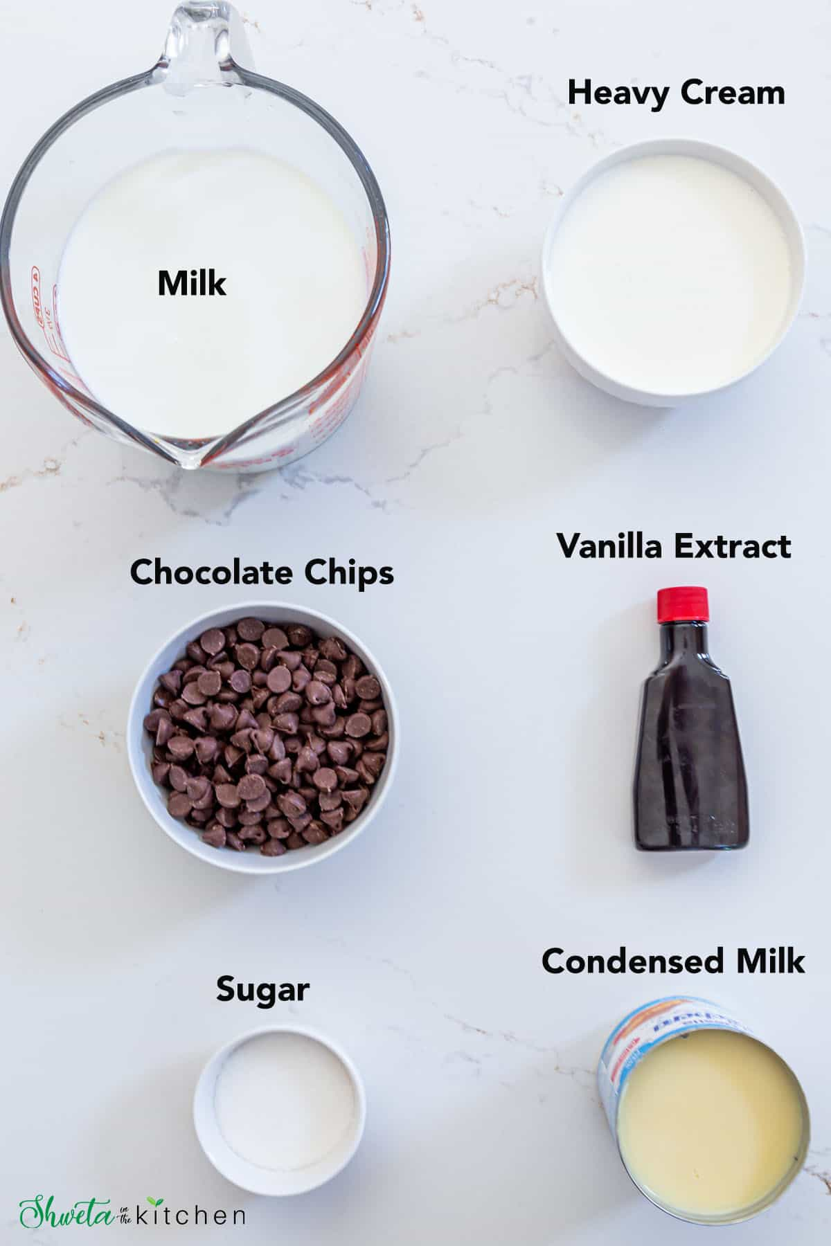 Hot Chocolate ingredients on a white surface
