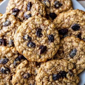 Heap of Oatmeal Raisin Walnut cookies on plate
