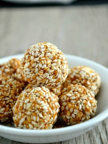 TilGul Ladoo stacked on white plate