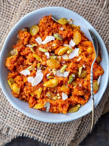 Carrot Halwa in a blue bowl with spoon
