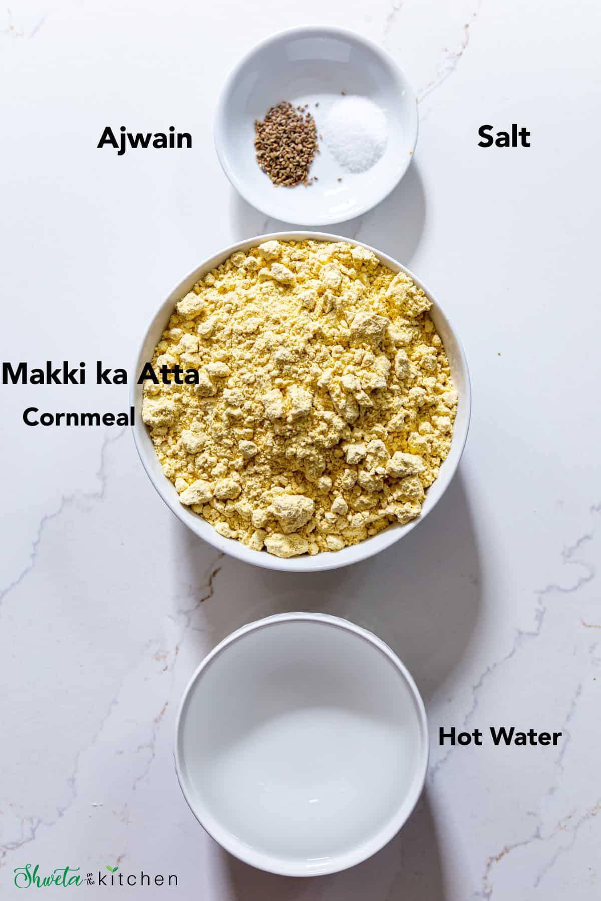 Makki ki roti ingredients in a bowl on white surface