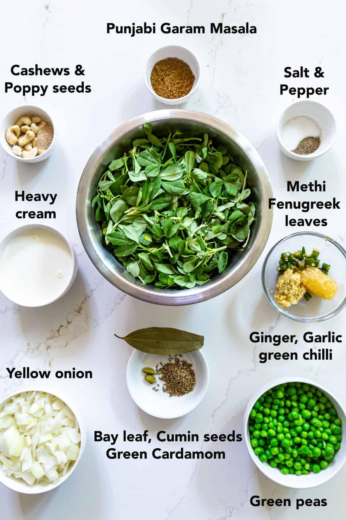 Ingredients for Methi matar malai in white bowls on white surface
