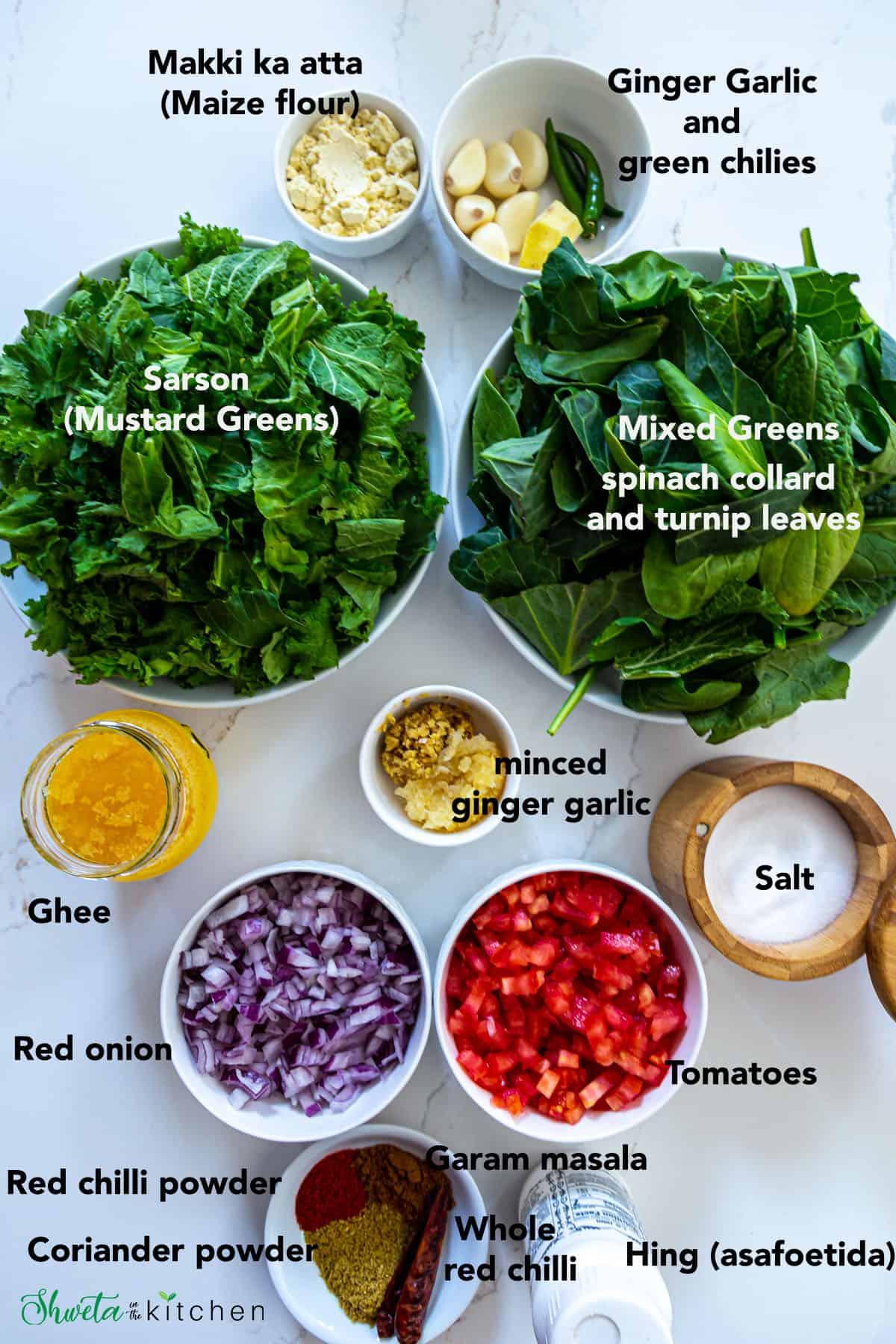 Sarson ka Saag Ingredients in bowls on white surface