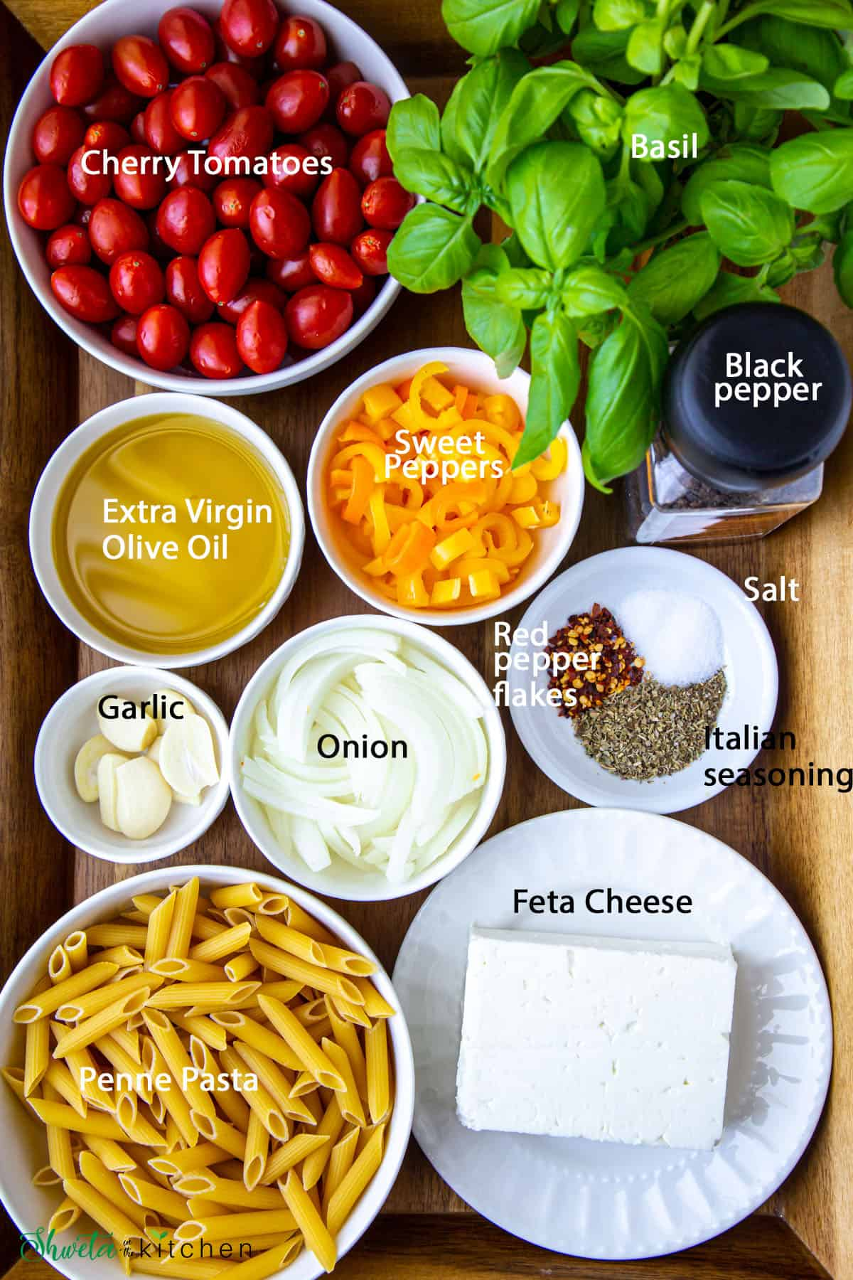 Baked Feta Pasta Ingredients in bowls on wooden surface