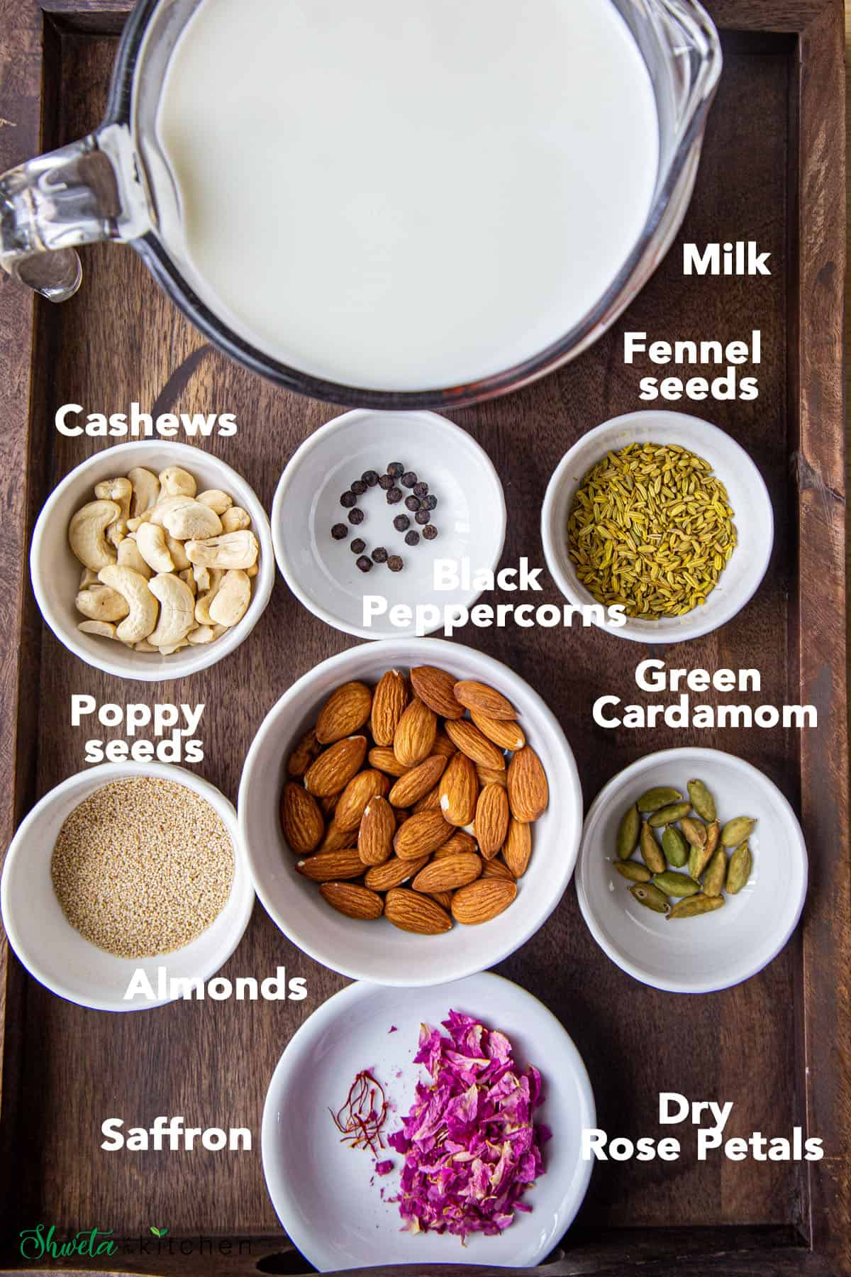 Thandai Ingredients in bowls on wooden platter
