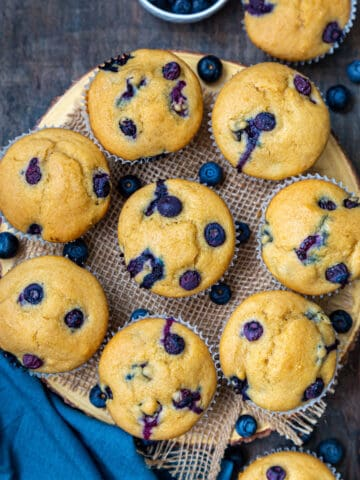 Top view of Eggless blueberry muffins on a round wooden board
