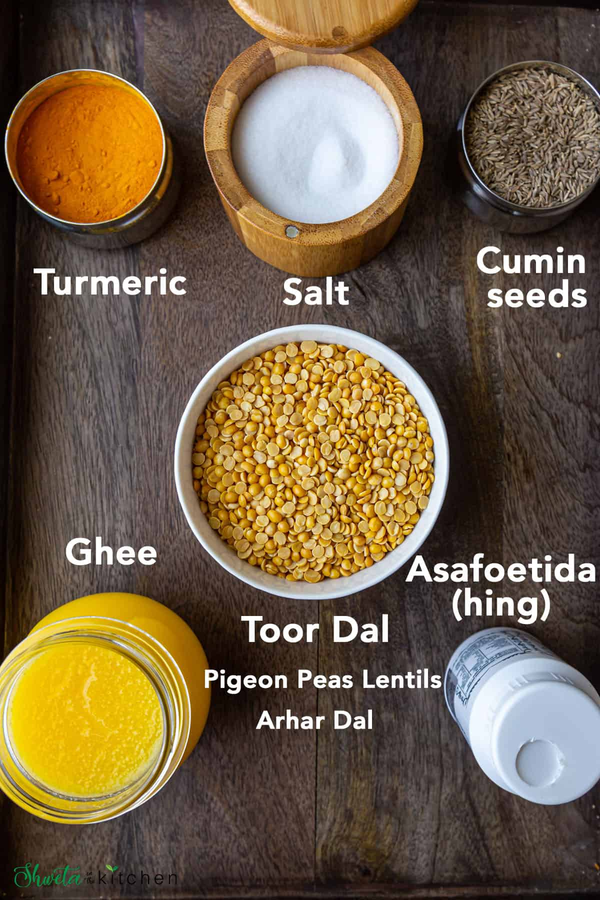 Varan Ingredients in bowl on wooden surface