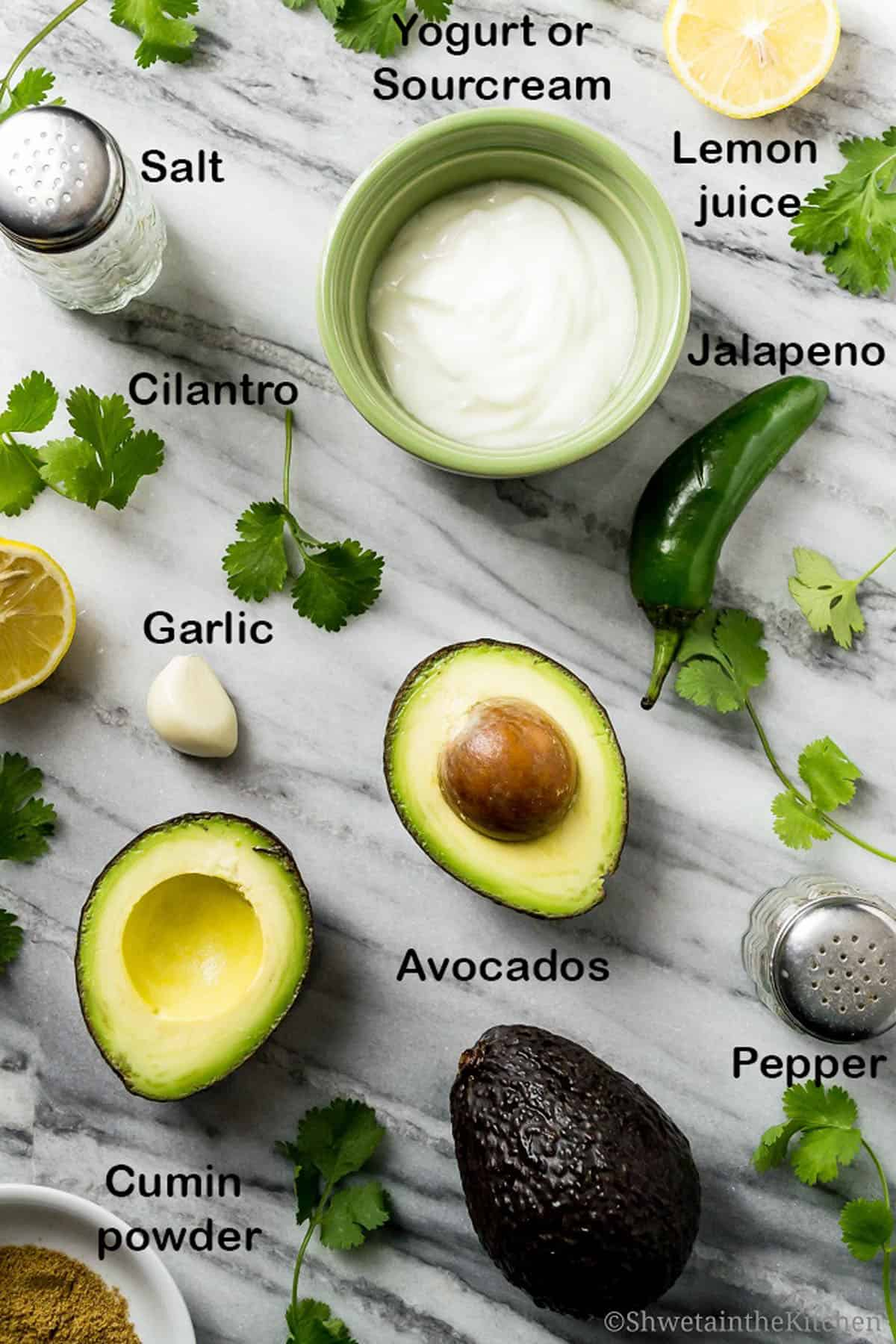 The ingredients for the avocado dip on a kitchen work surface