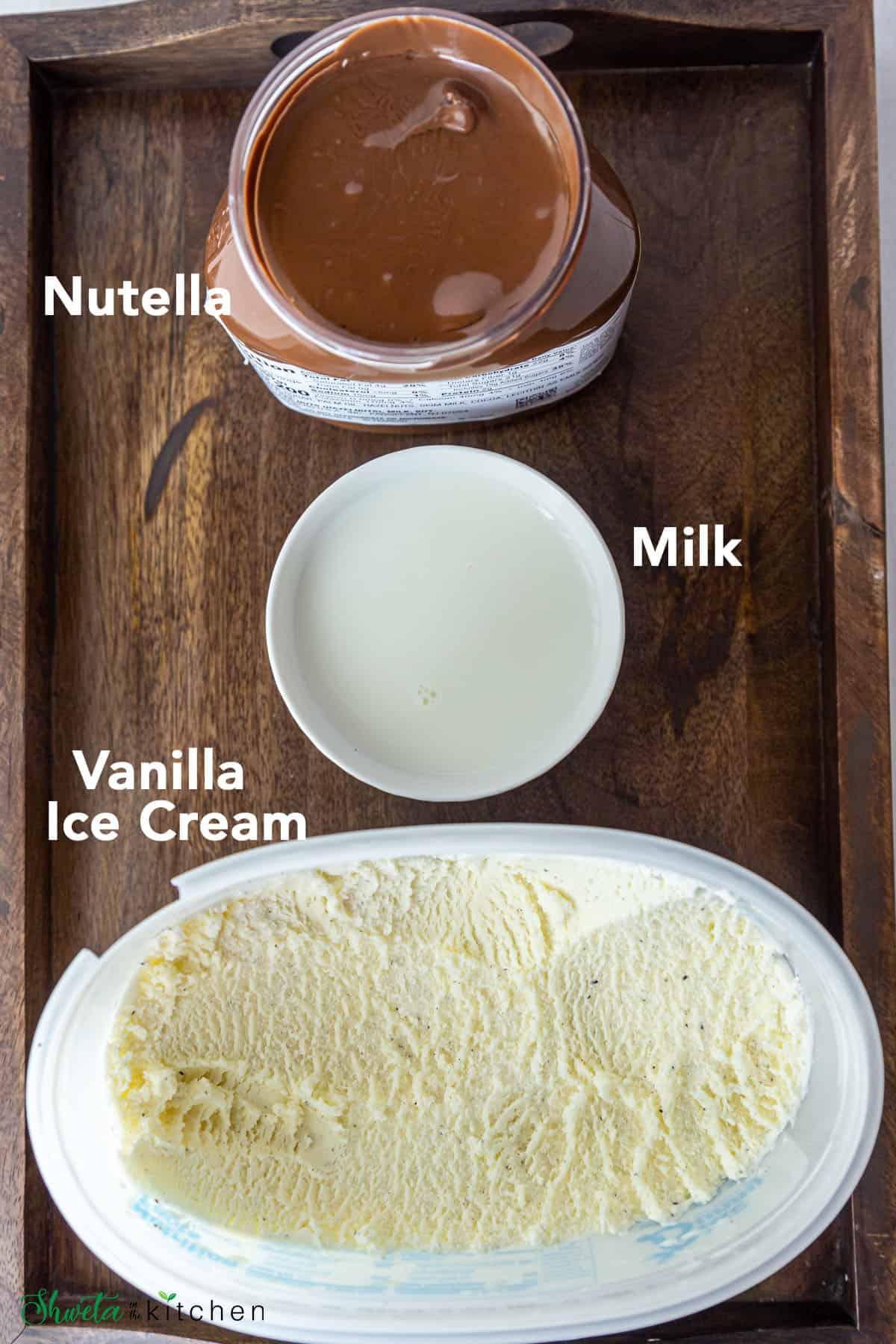 Nutella Milkshake Ingredients on aa wooden board