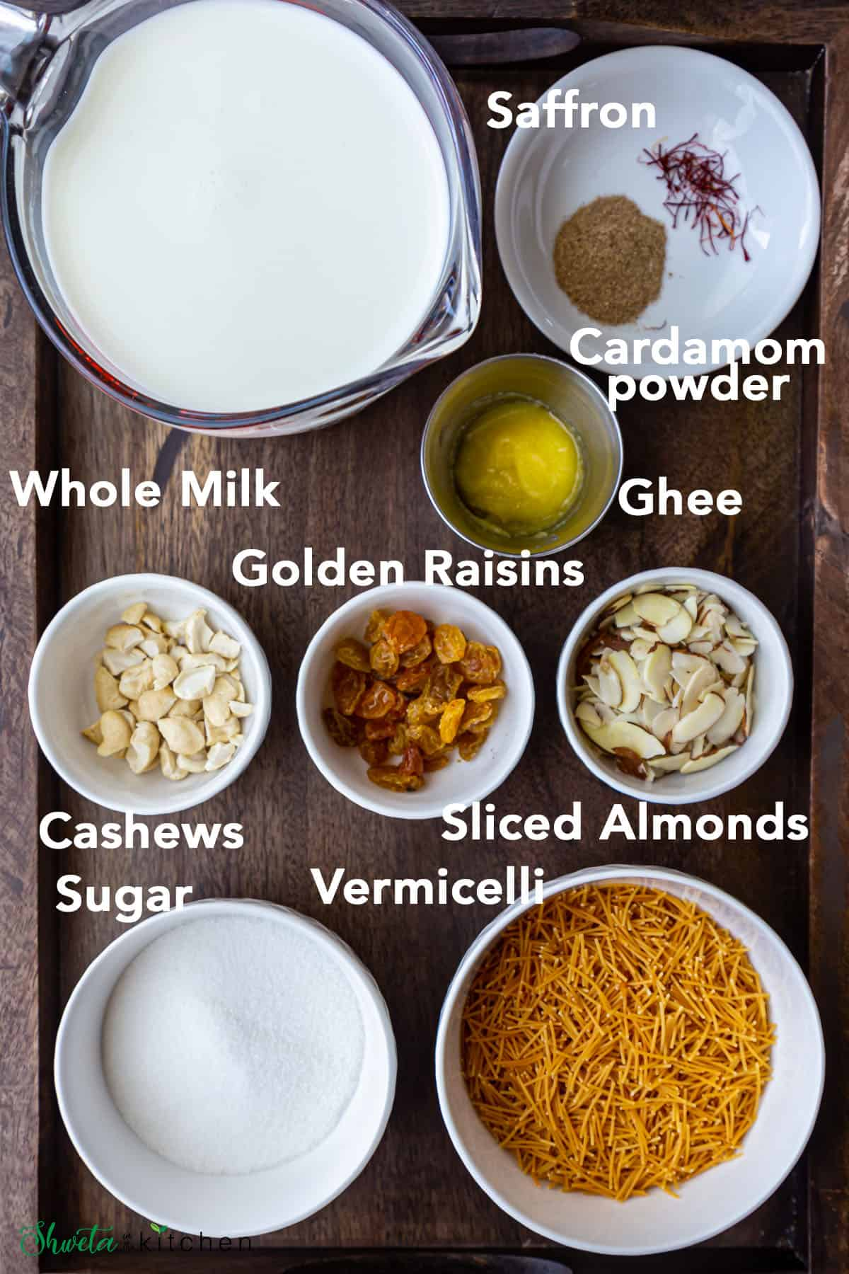 Vermicelli Kheer ingredients in white bowls on wooden tray