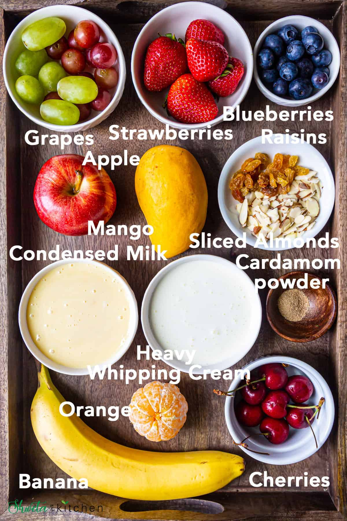 Indian fruit salad ingredients on wooden tray